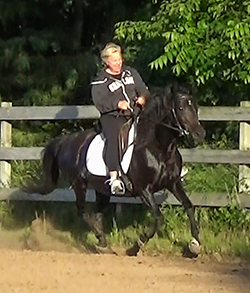 Lady cantering right lead