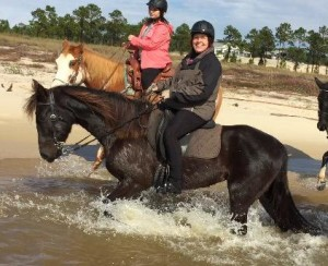 Abbie and I riding on the ocean coast.
